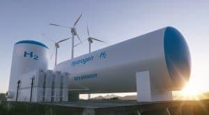 Miejsce produkcji energii odnawialnej: zbiornik na wodór na tle turbiny wiatrowej