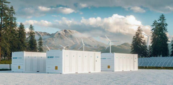 Nowoczesny system kontenerowej elektrowni magazynującej energię z bateriami słonecznymi i turbiną wiatrową położoną w naturze z Mount St. Helens w tle. Renderowanie 3d.