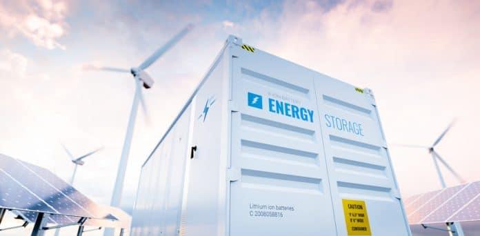 Koncepcyjne obraz nowoczesnego systemu magazynowania energii baterii z turbin wiatrowych i elektrowni słonecznych w tle. Renderowanie 3d