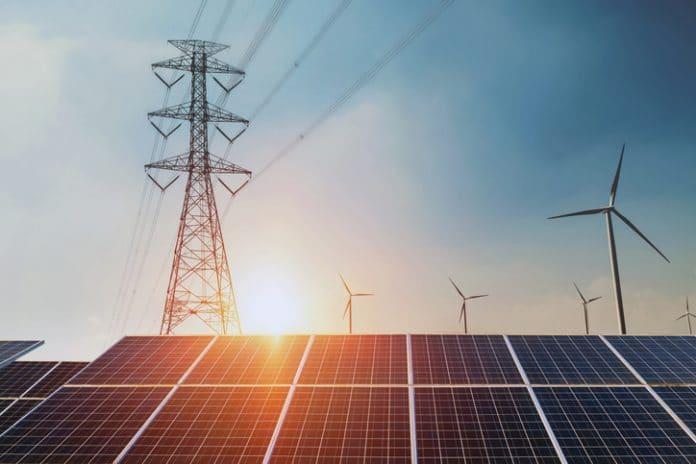 Panele słoneczne i turbiny wiatrowe na tle połączeń sieci energetycznej